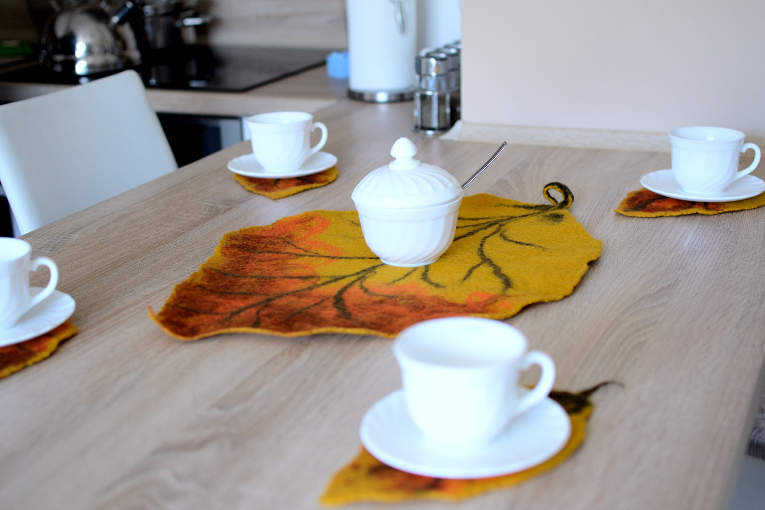 Autumn felted coasters in leaf shape