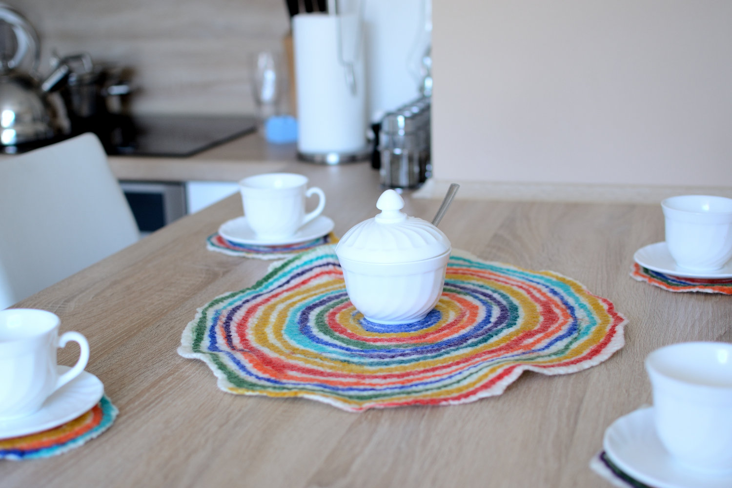 Colorful kitchen coasters felted of merino wool