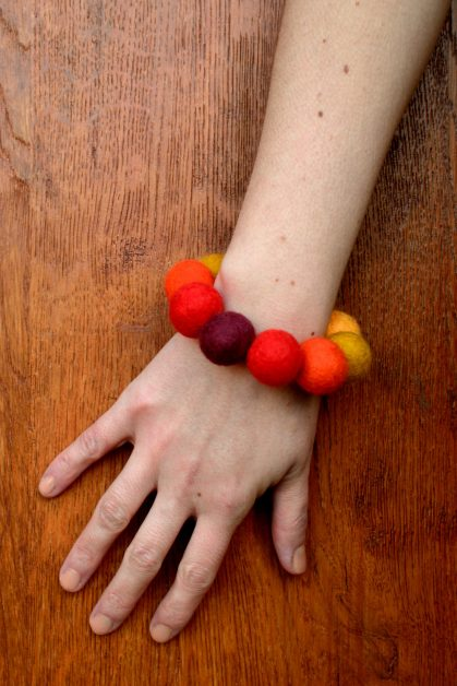 Felt bead bracelet in red palette