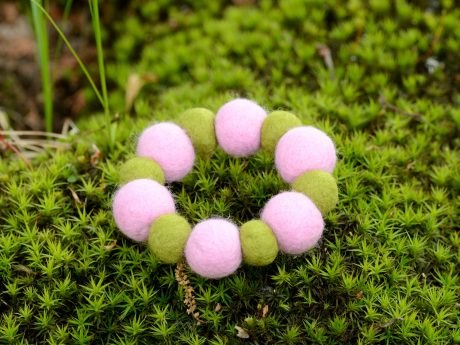 Felted bead bracelet on the moss