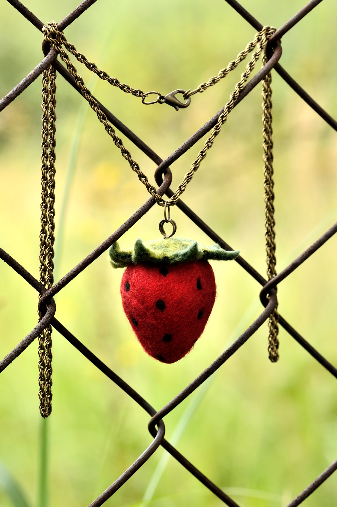 Strawberry pendant with felted fruit and long chain