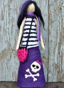 Emo figurine with skull and strawberry bag