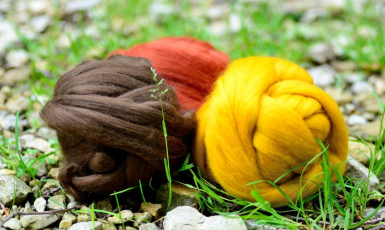 Three balls of merino wool tops