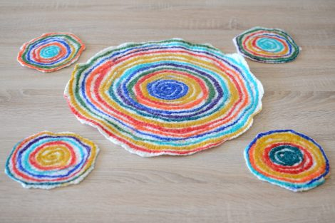 Five kitchen coasters felted of colorful wool