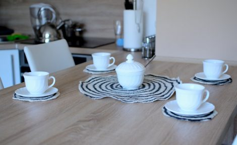 Set of five table coasters in black and white