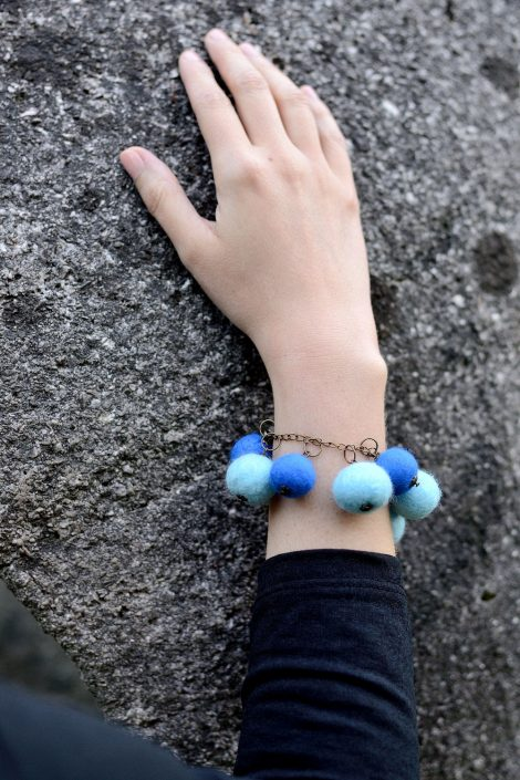 Felted ball bracelet in blue tones