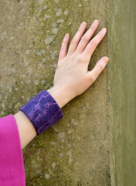 Felted cuff bracelet made of wool and silk fibers