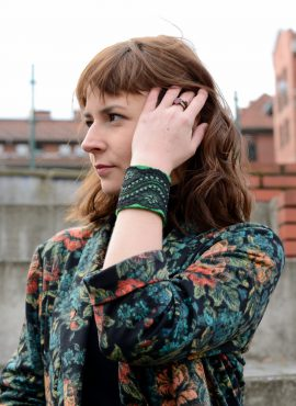 Black lace cuff with green felted base