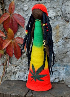 Jamaican figurine with marijuana leaf