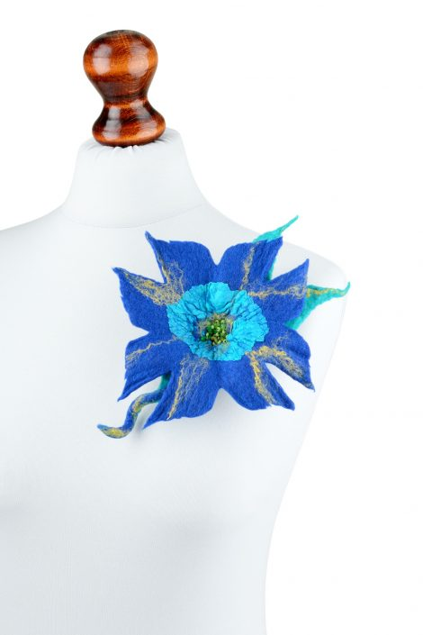 Blue felt brooch with exotic design