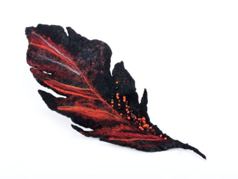 Felted black feather brooch