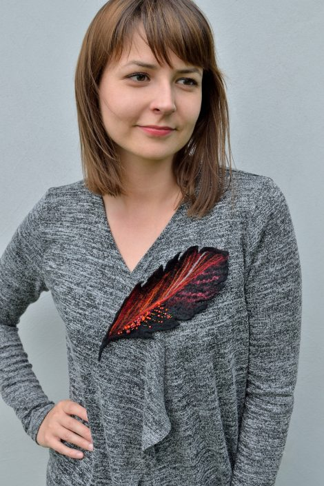 Felt feather brooch in black and red
