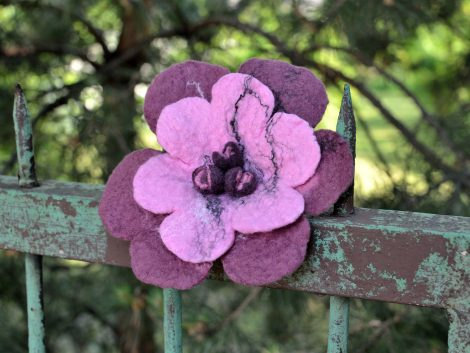 Felted flower brooch in magenta color