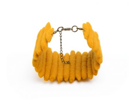 Yellow bracelet felted of natural wool