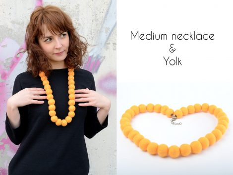 Massive felt bead necklace in yolk color