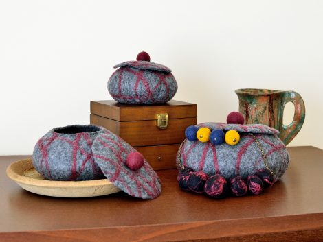 Set of jewelry boxes made in felting technique