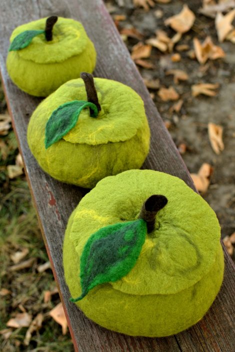 Green apples made of wool fibers