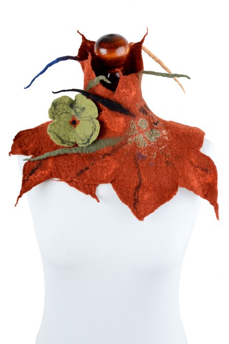 Rust neck warmer for a cosplay fairy costume with leaf edges and clover pin